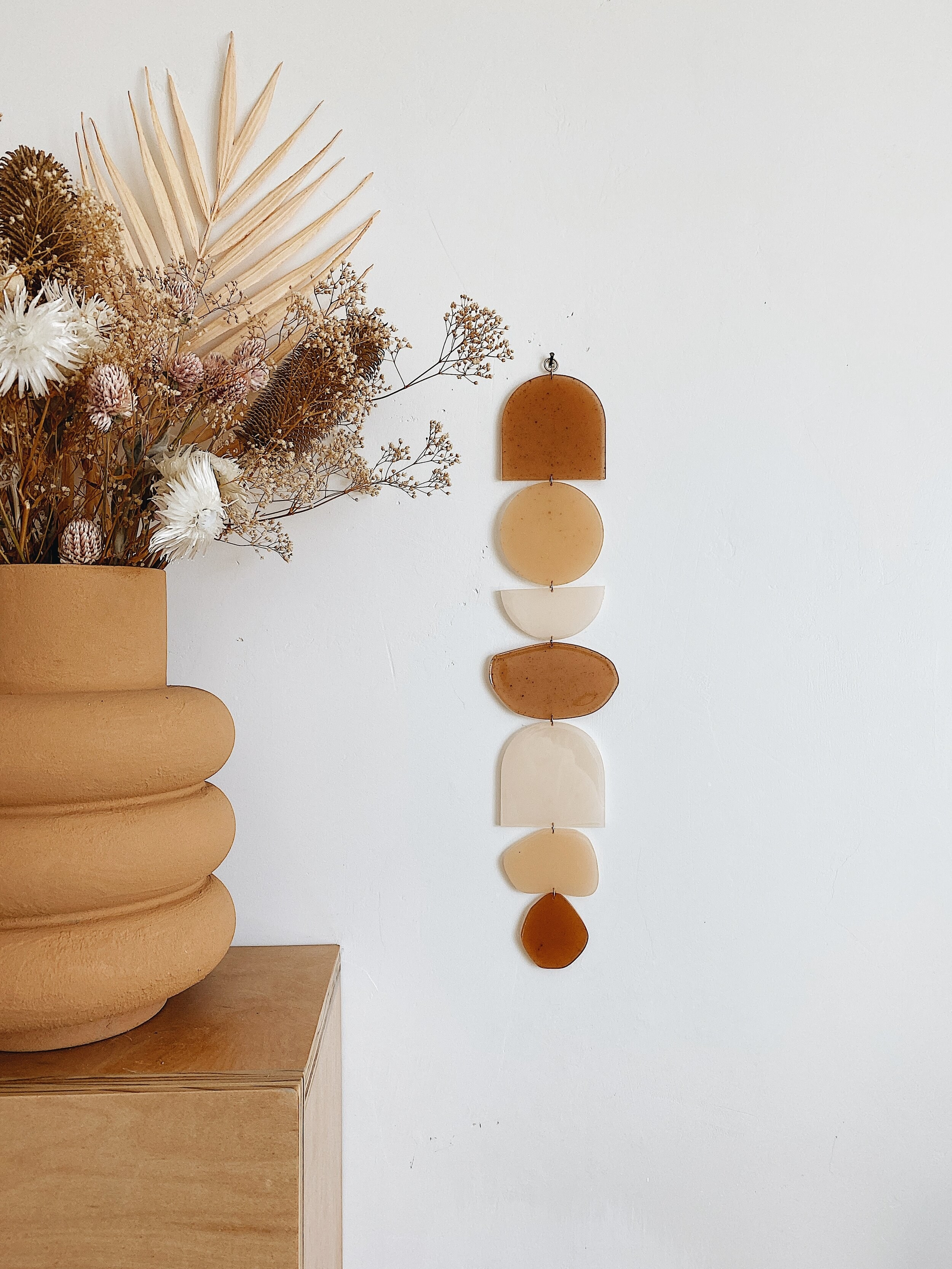 a neutral-colored wall hanging