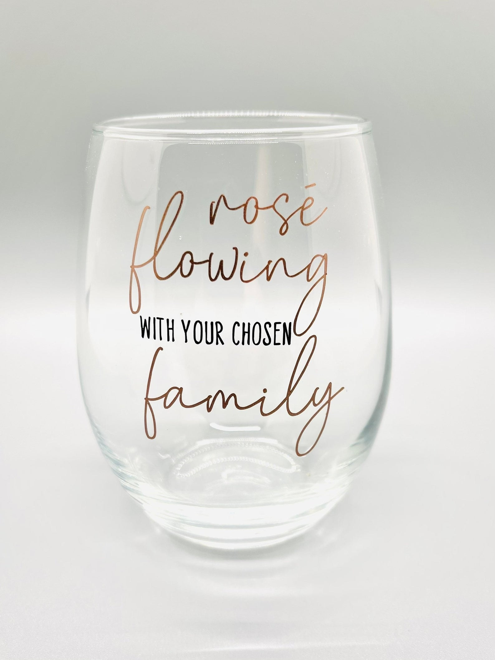 "a stemless wine glass that says ""rose flowing with your chosen family"""