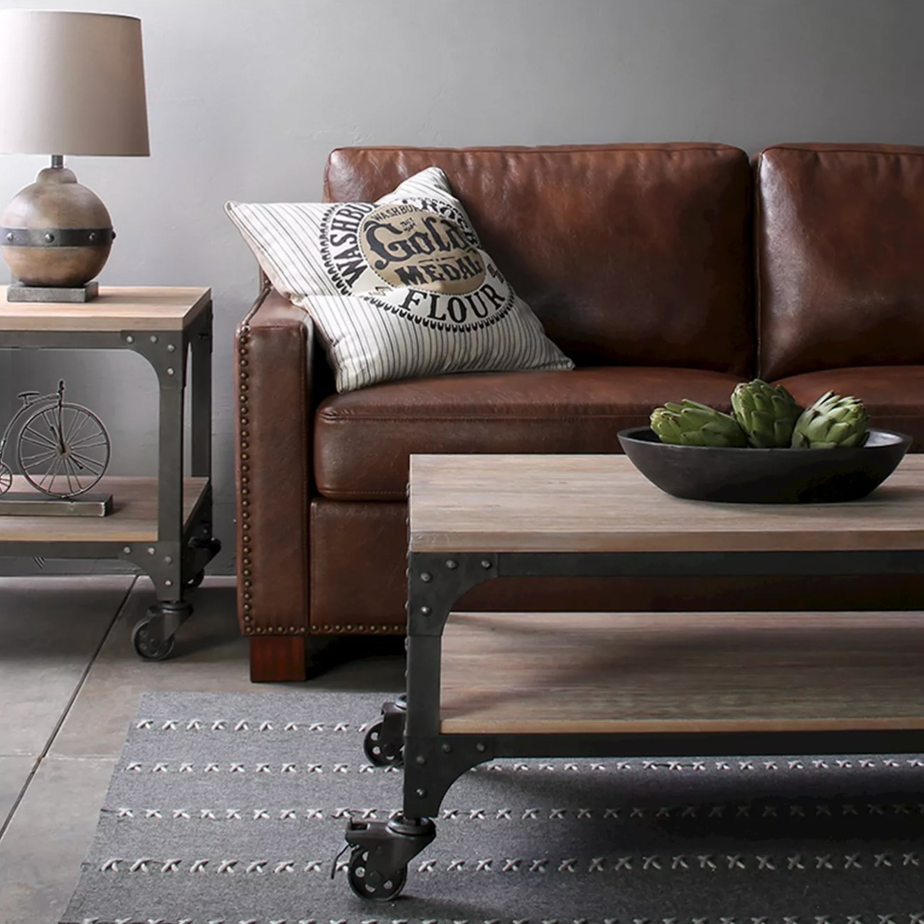 The wood coffee table in weathered gray