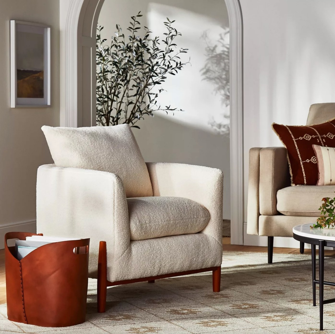 The accent chair with wood legs and beige seat