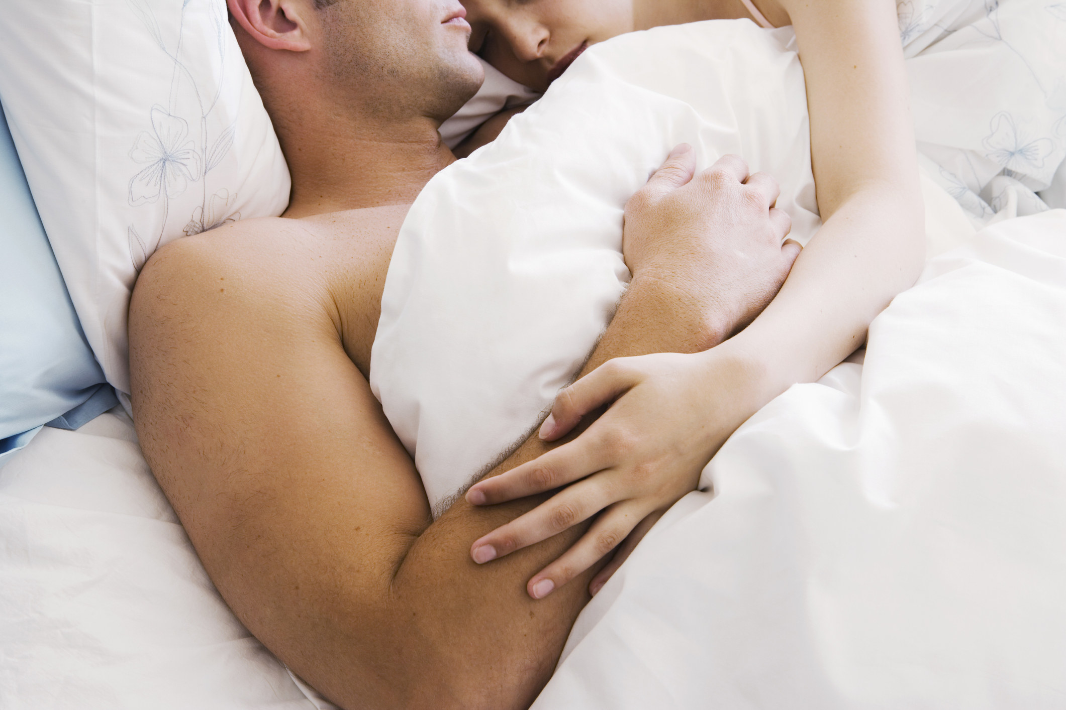 two people in bed snuggling