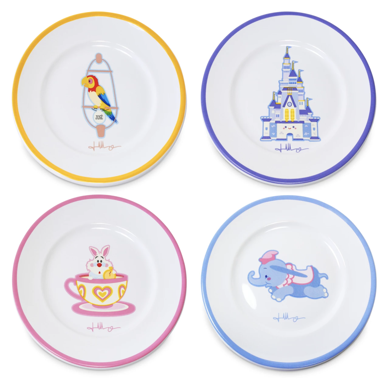 a set of four plates one has a tiki room bird on it, another has cinderella castle, annother is the rabbit from alice in wonderland in a teacup, and the last one dumbo