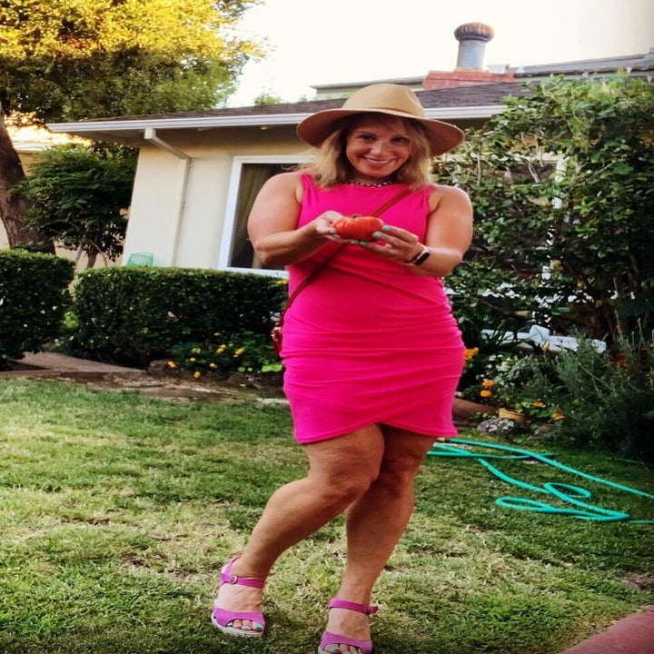 person wearing a pink t shirt dress while in a backyard