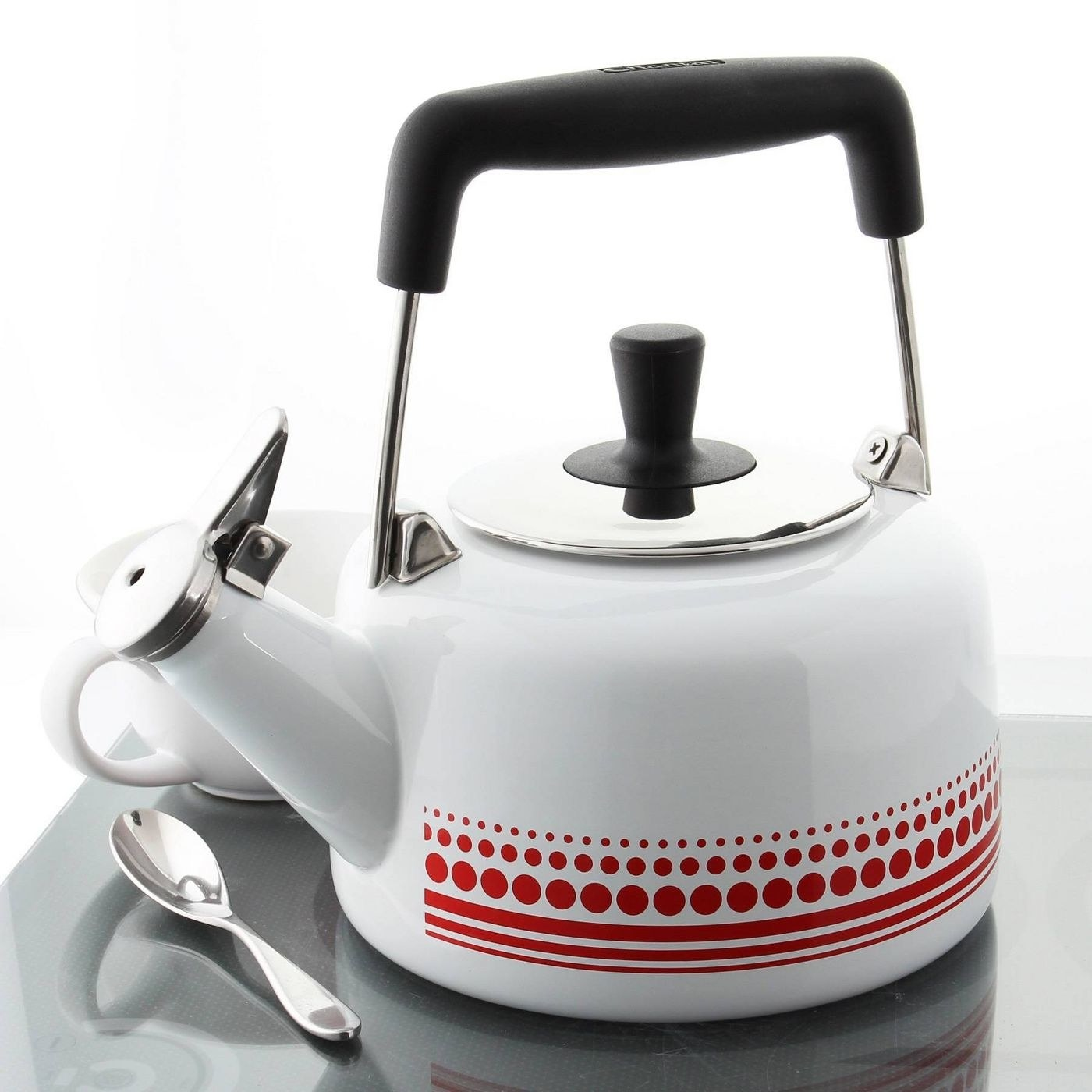 white tea kettle with a red decal on it