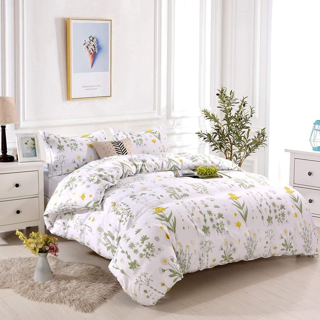 the yellow, green, and white floral bedding set with shams, a comforter, and sheets