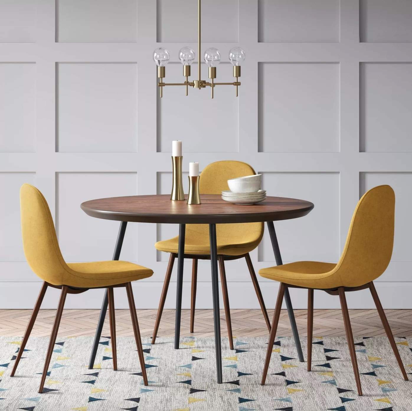 The two piece set of upholstered diing chairs in mustard with wood legs
