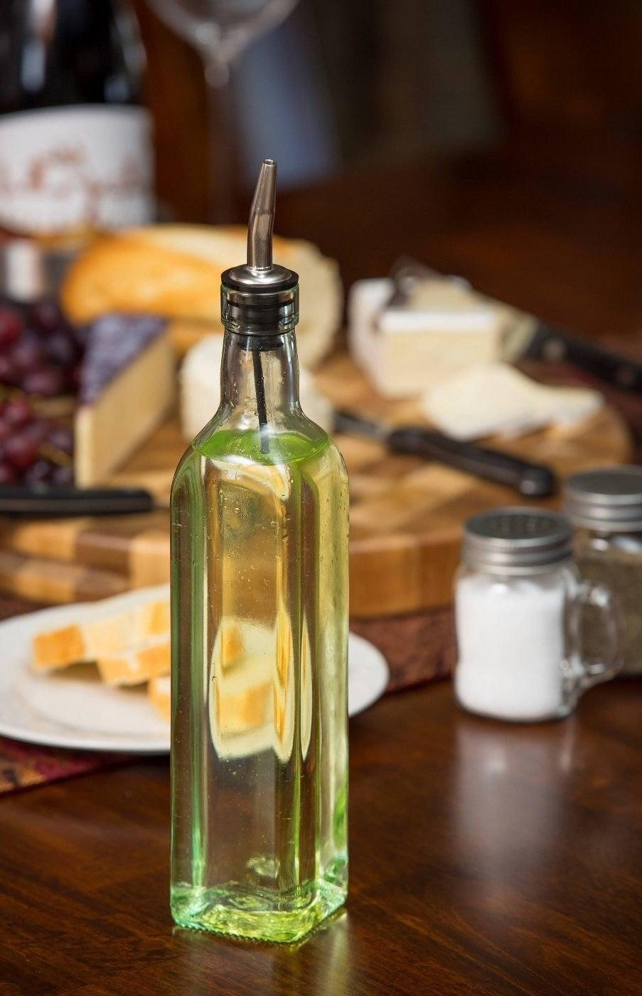 olive oil dispenser filled with olive oil