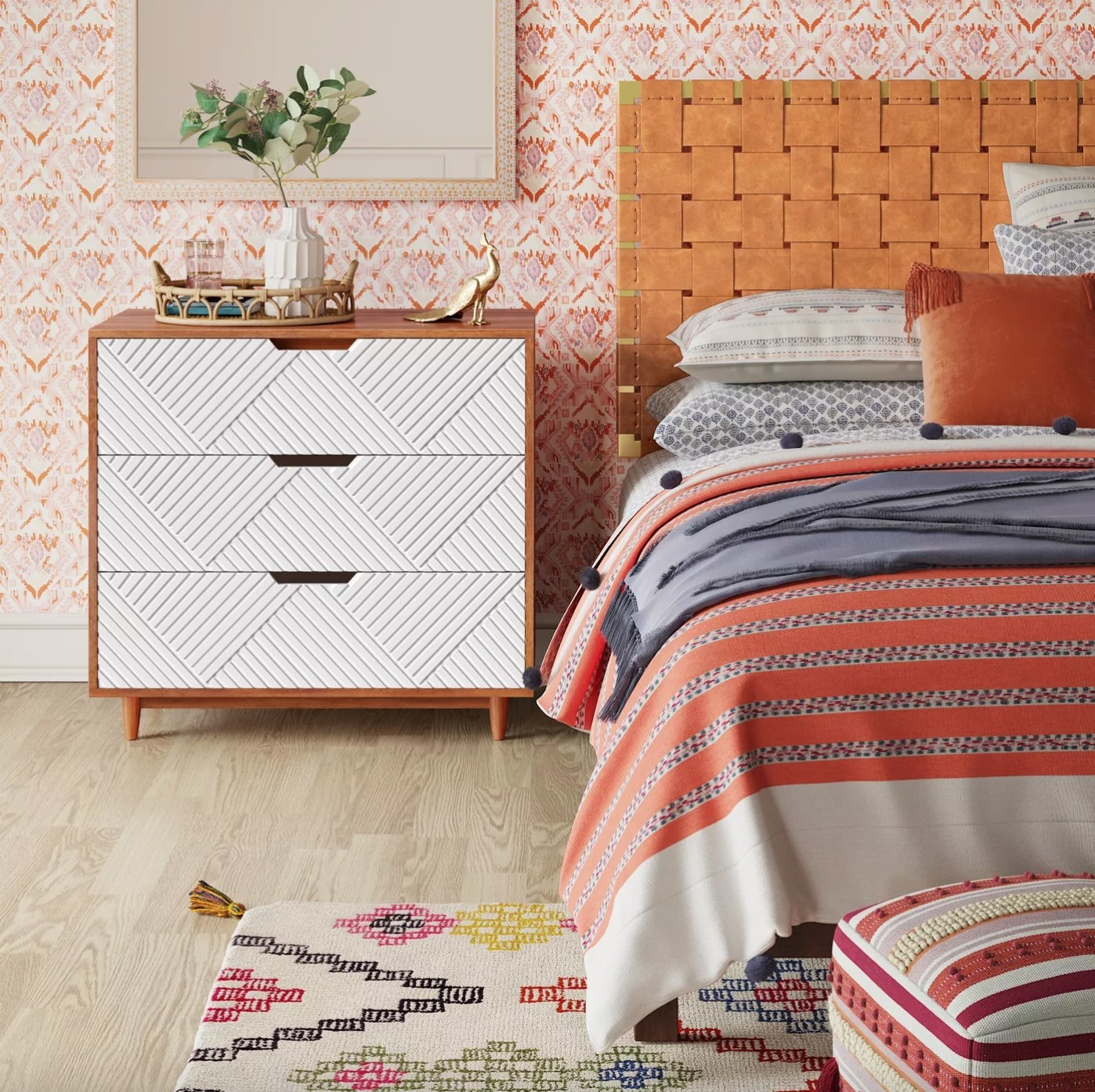 The wood dresser with white drawers