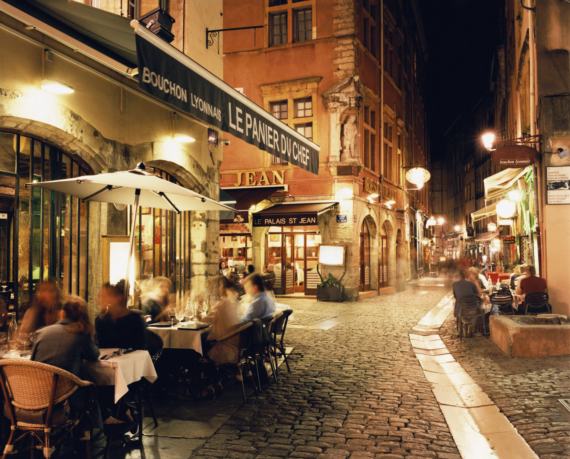 French bistro with diners outside.