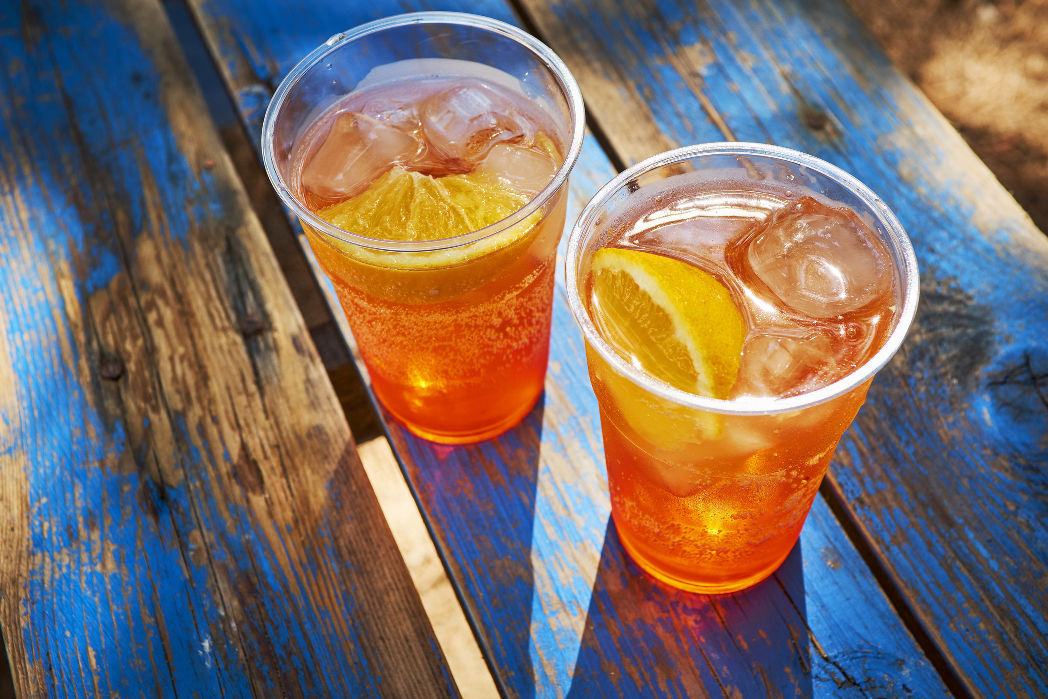 Two aperol spritz over ice.