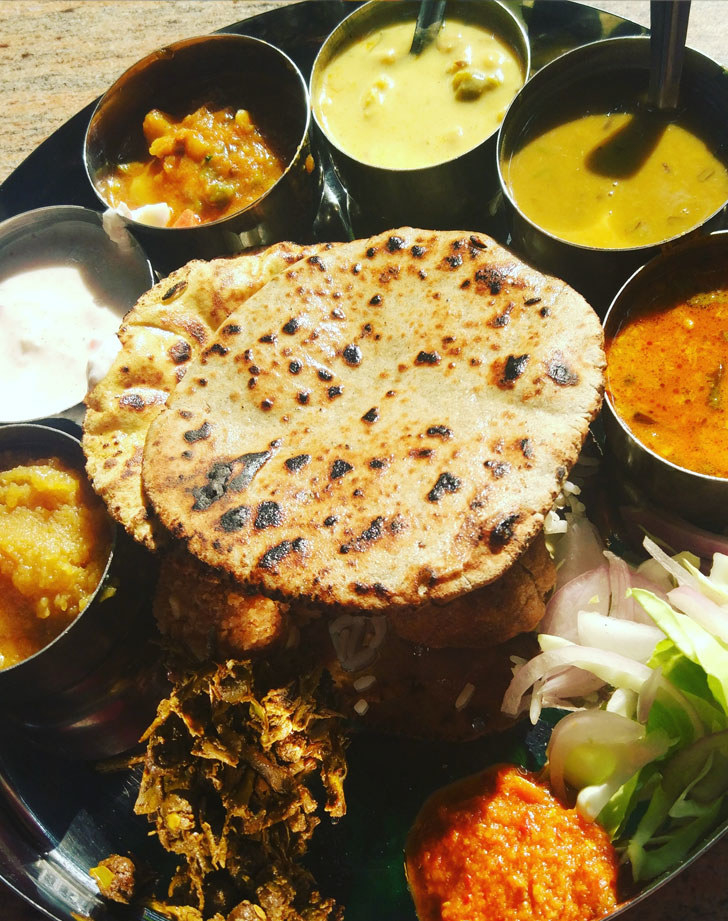 A platter of Indian food with curries.