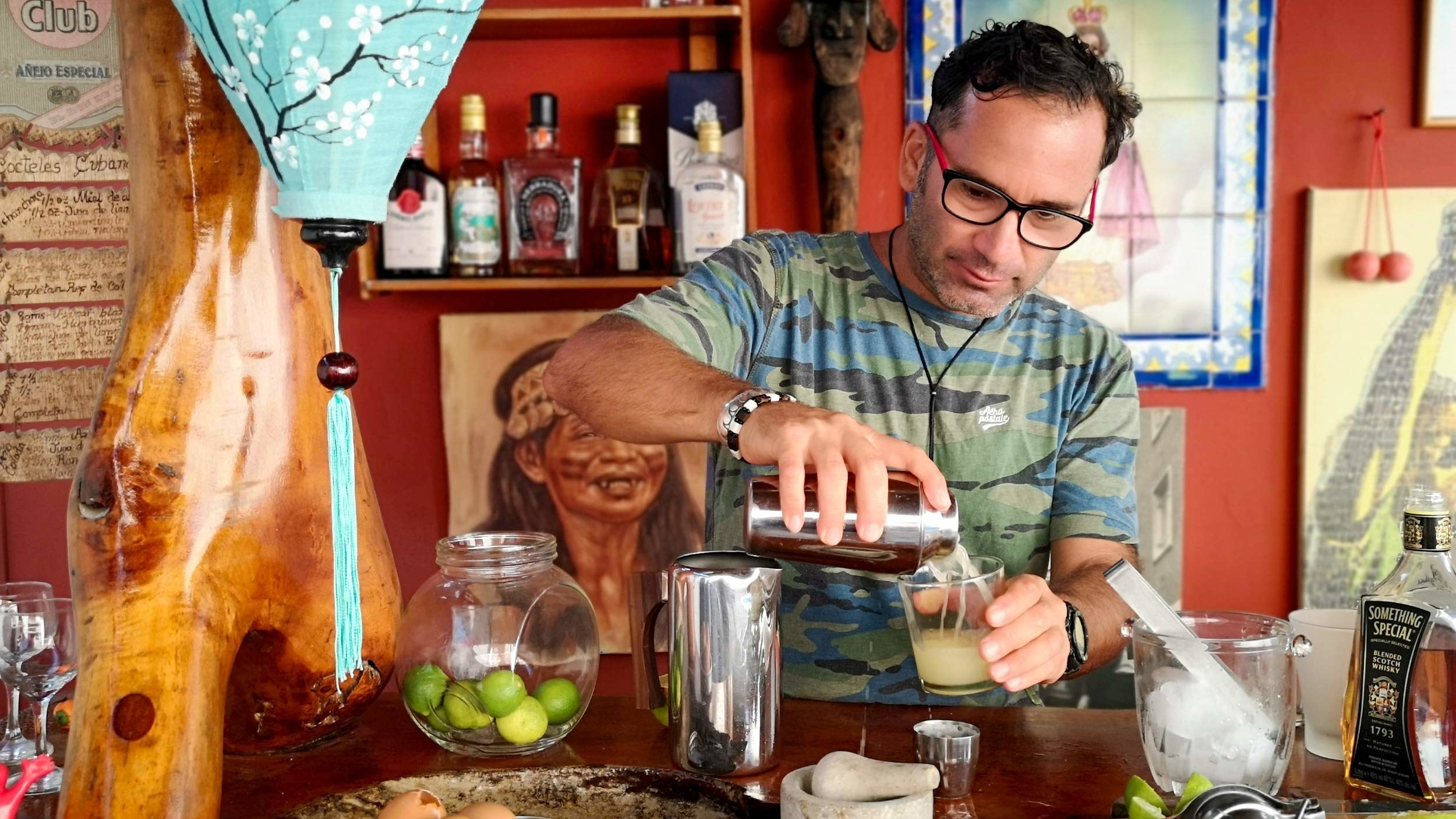 host making a Pisco sour
