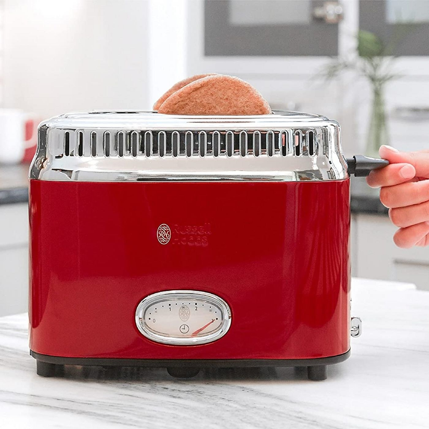 red vintage-style toaster with bread on the top