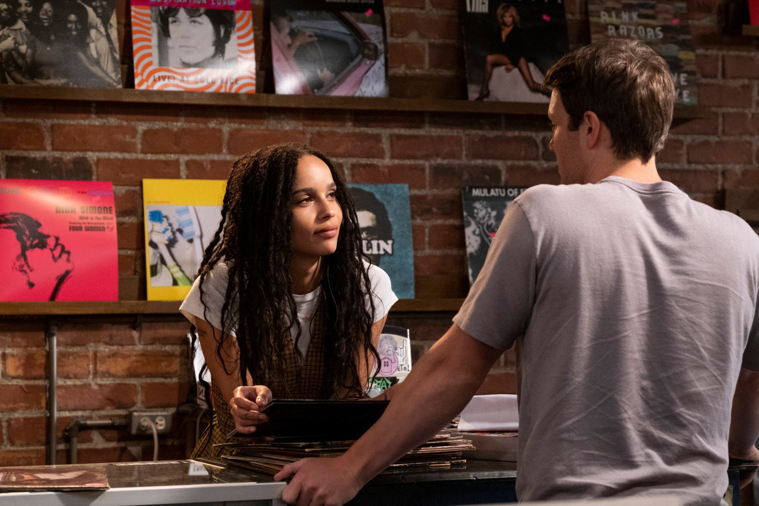 """Zoë Kravitz and Jake Lacy (back to camera) in """"Weird...but Warm"""""""