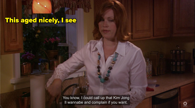 amy's mom in kitchen making poor taste joke about kim jong II