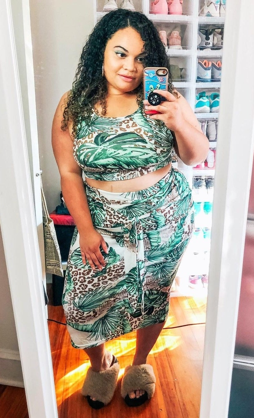 buzzfeed editor wearing the two-piece set in a green and brown jungle print