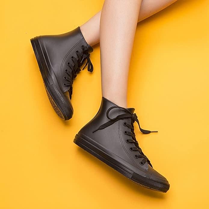 model wearing high top sneaker-like rain boots