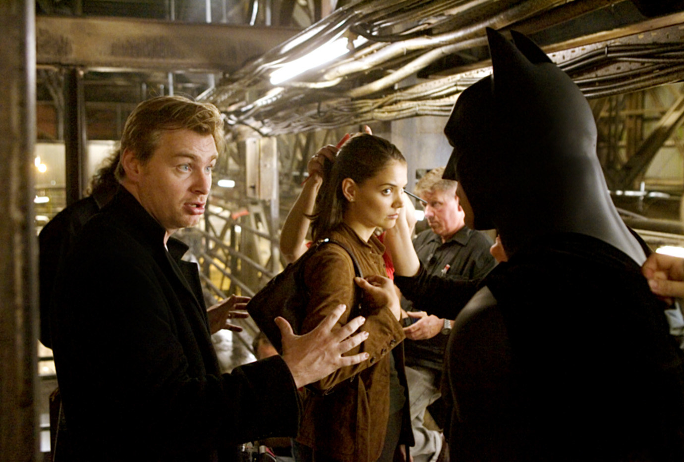 Photo of Christopher Nolan directing Christian Bale and Katie Holmes on the set of Batman Begins