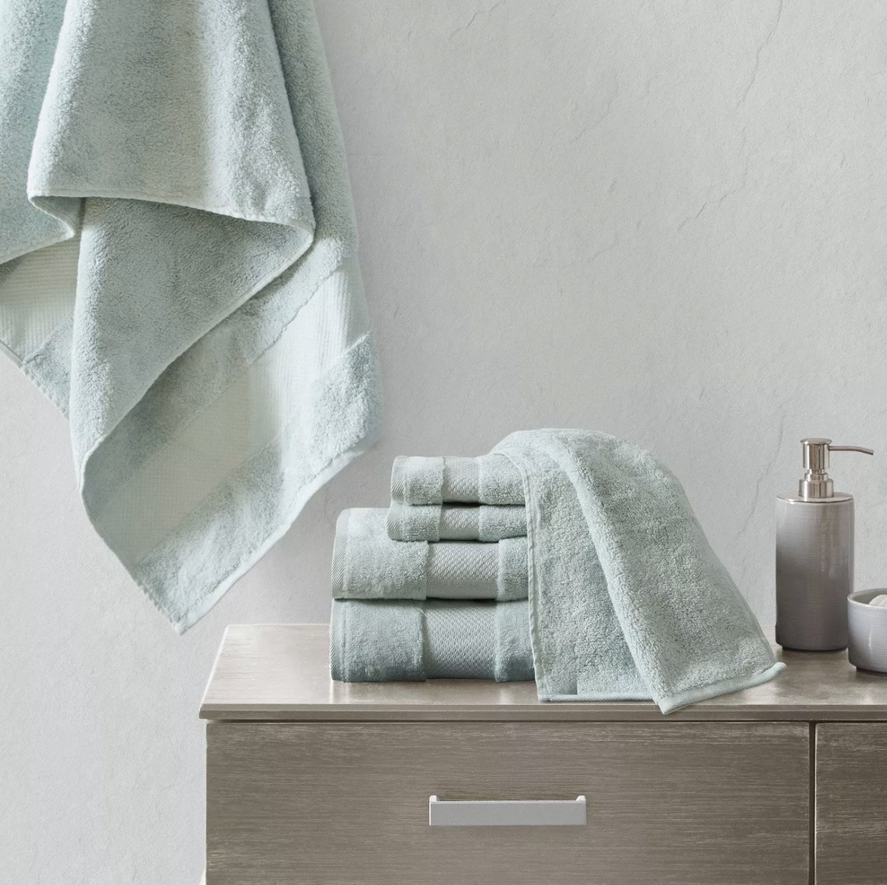 Set of bath towels on bathroom counter