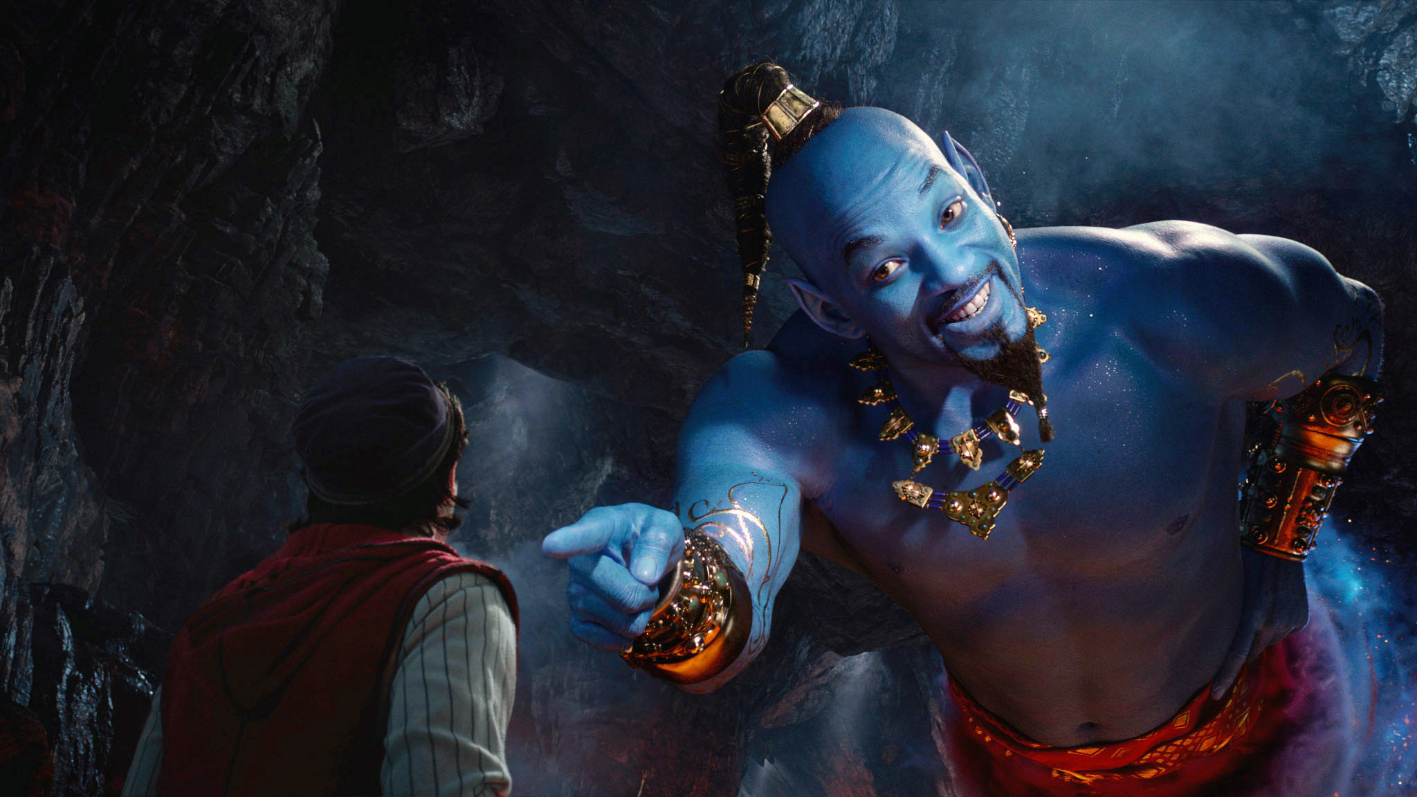 Photo of Will Smith as the Genie pointing at Aladdin