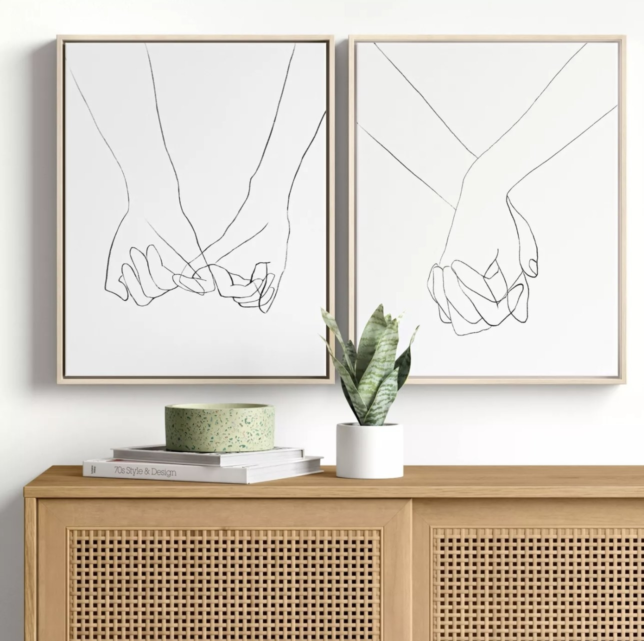 Hands wall décor hung in living room