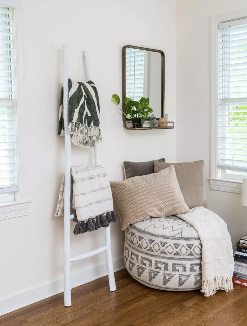 Ladder holding blankets in living room
