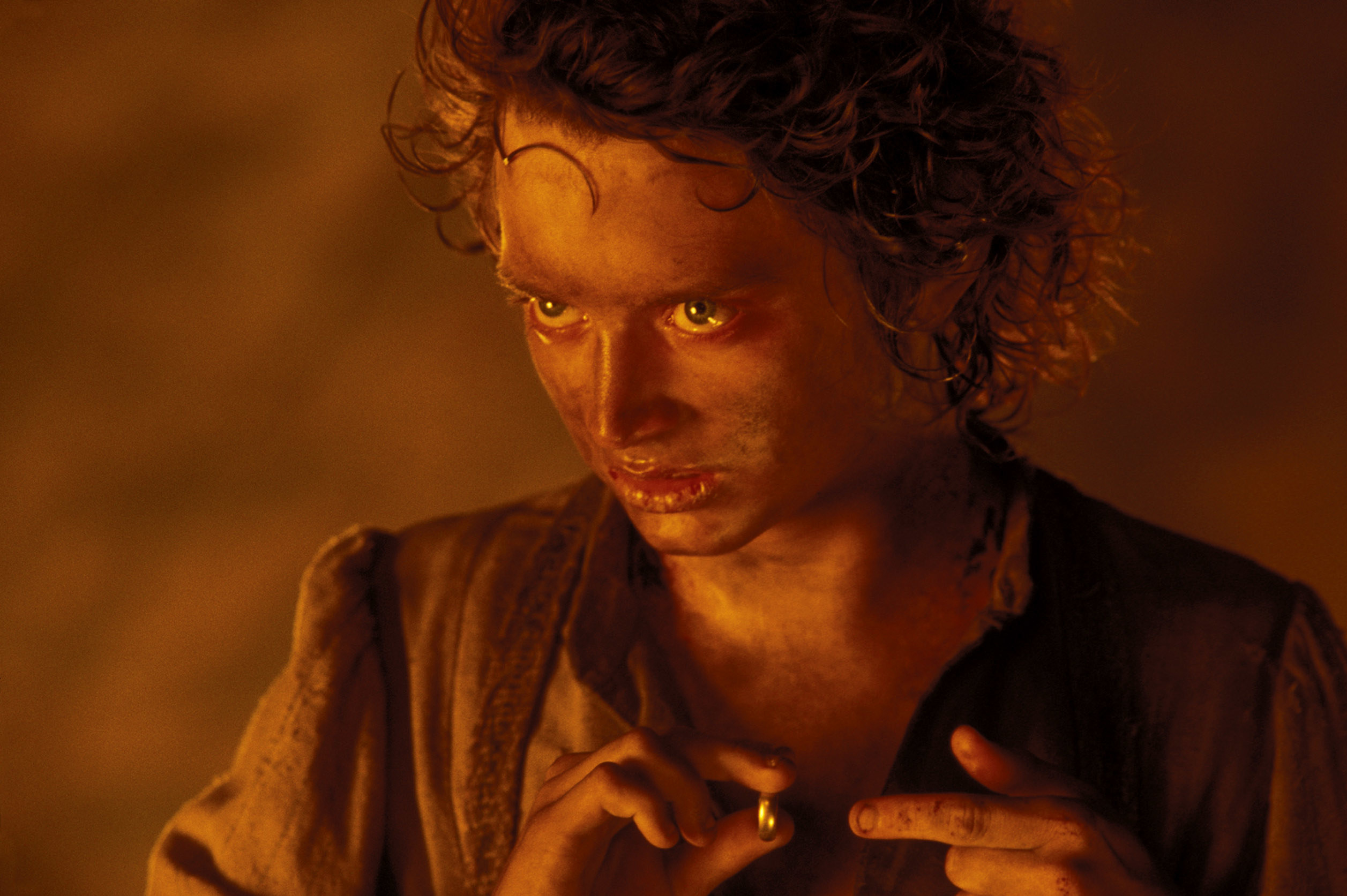 Photo of Frodo about to put on the ring