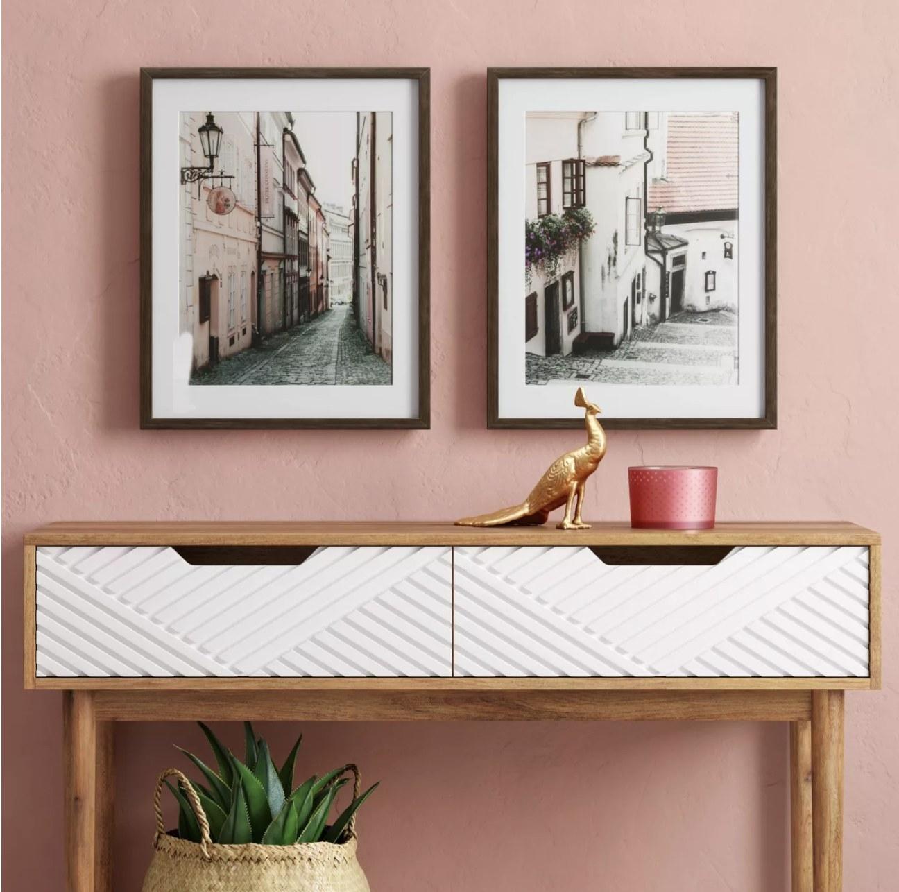 European photos on pink wall