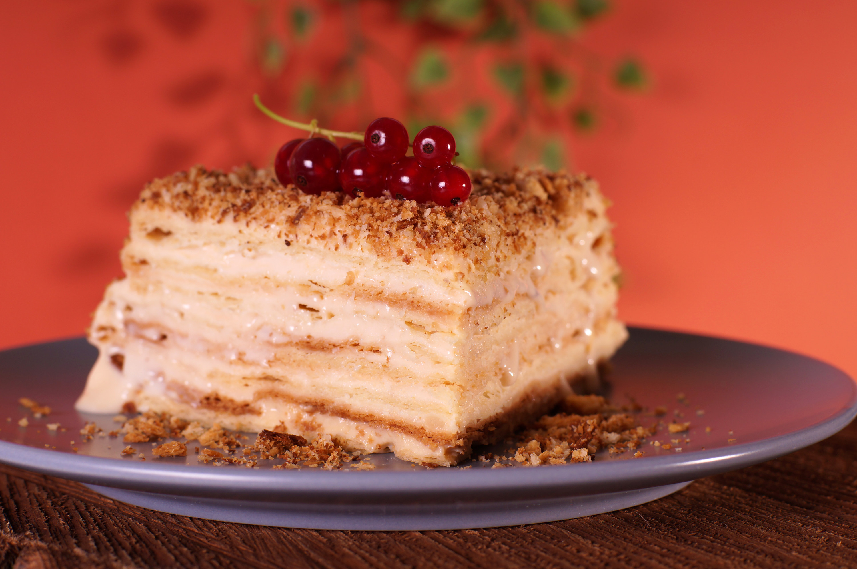 Layered cake with cream layers and a textured topping.