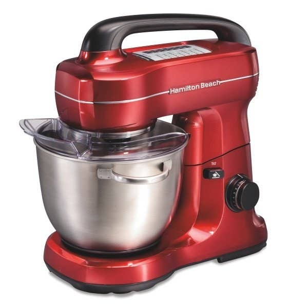 The standing mixer, with silver bowl and red body