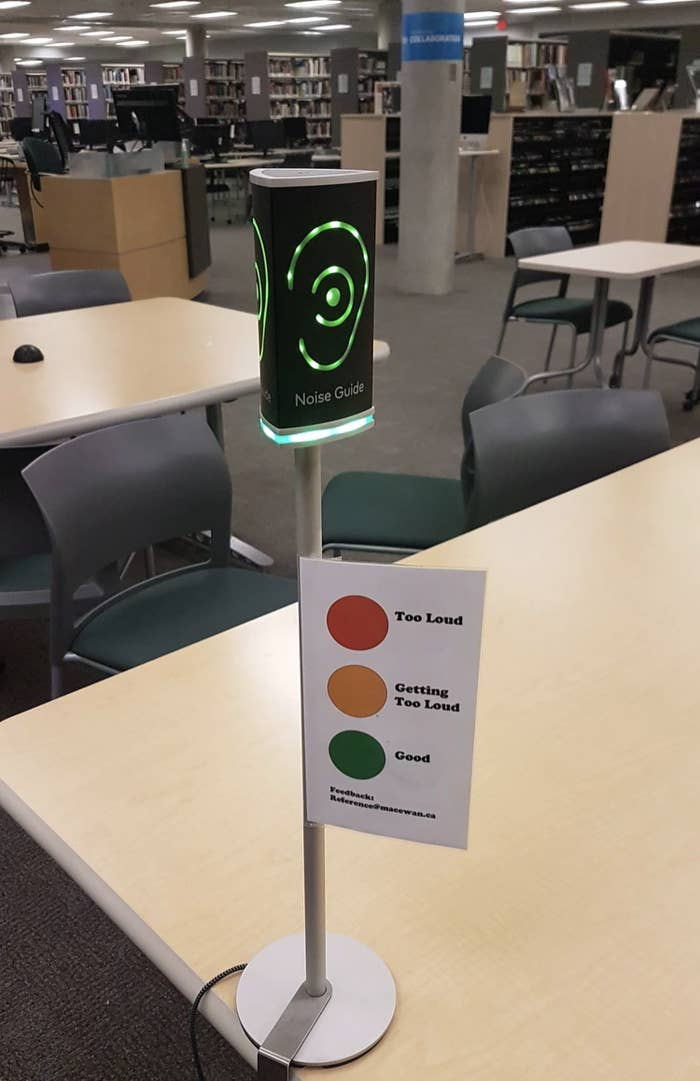 A device on the table of library that glows different colors based on the noise level