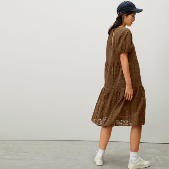 A model wearing the dress in walnut