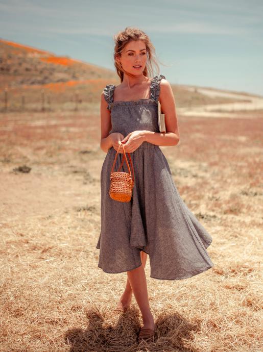 A model wearing the Vanna Hemp Midi Dress