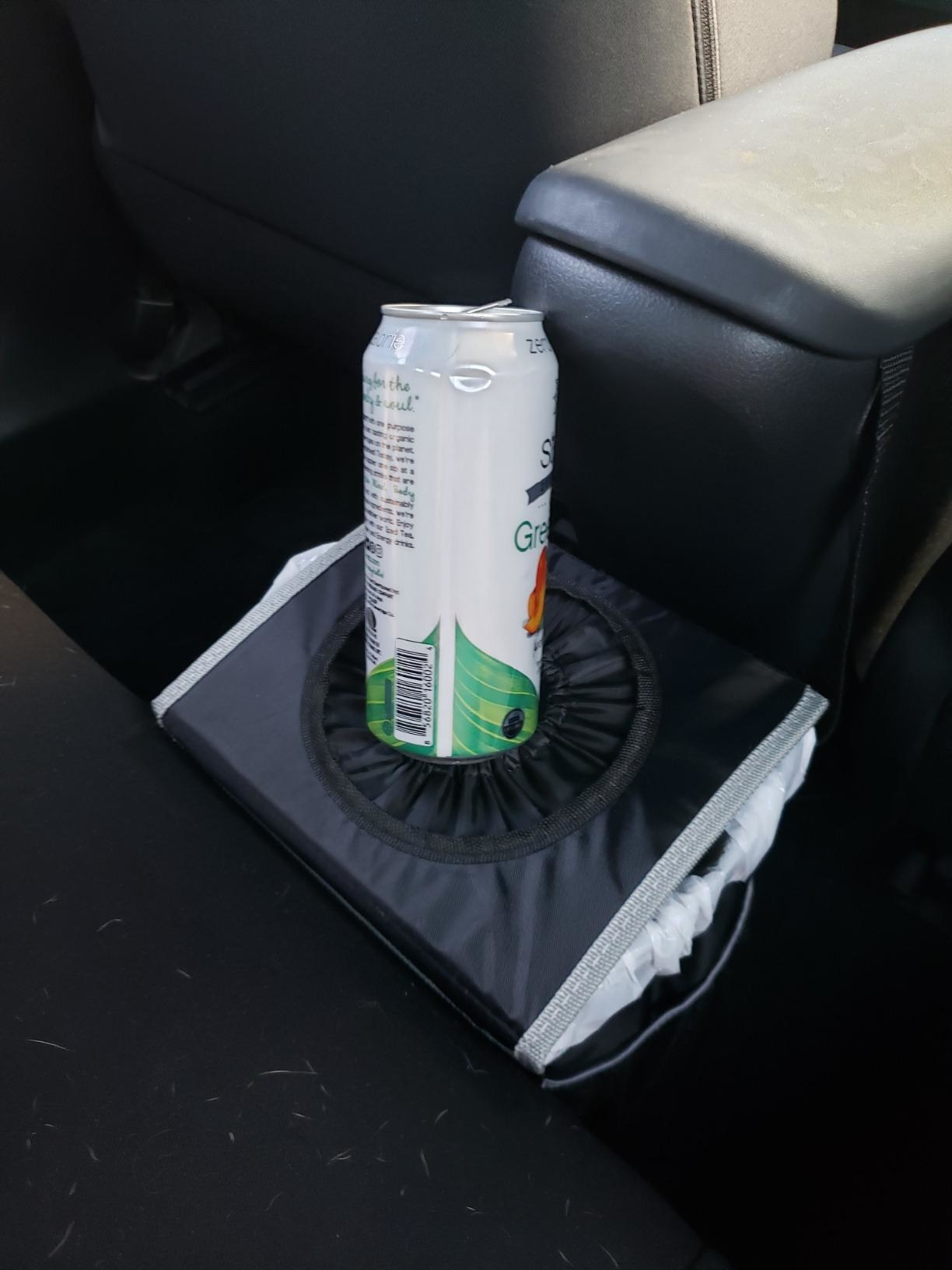 the trash can with a drink on top