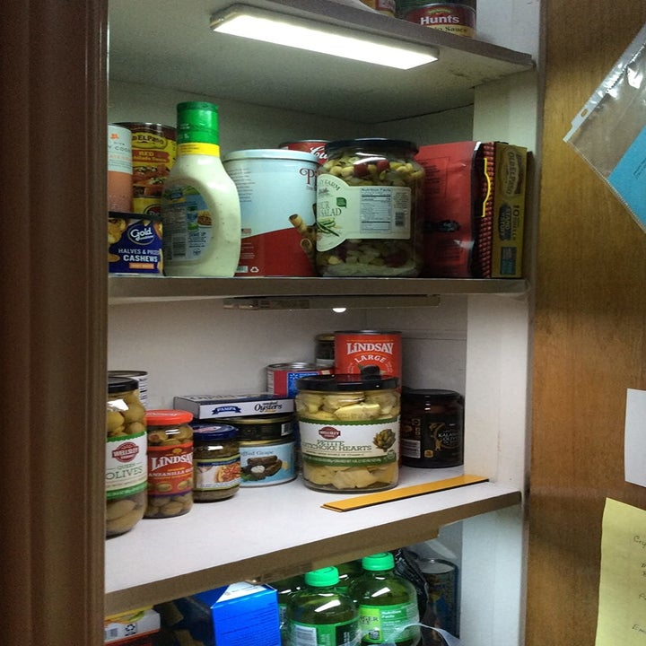 a reviewer photo of a pantry with one of the lights installed on the ceiling