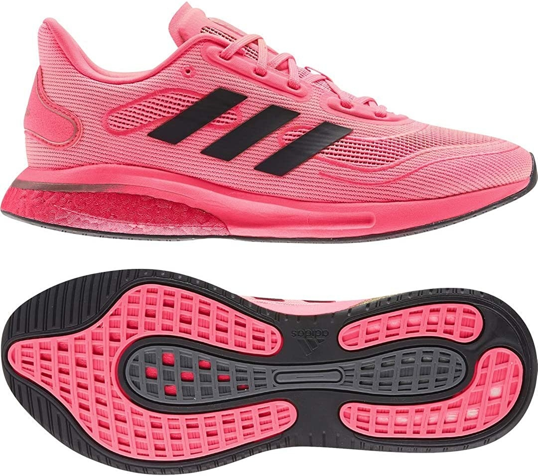 The Adidas shoes in Signal Pink with three black stripes on the side, a cushioned heel and textured bottom
