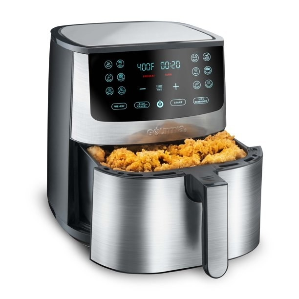 The stainless steel finish air fryer, which has a pull-out drawer in its bottom half where the food is placed
