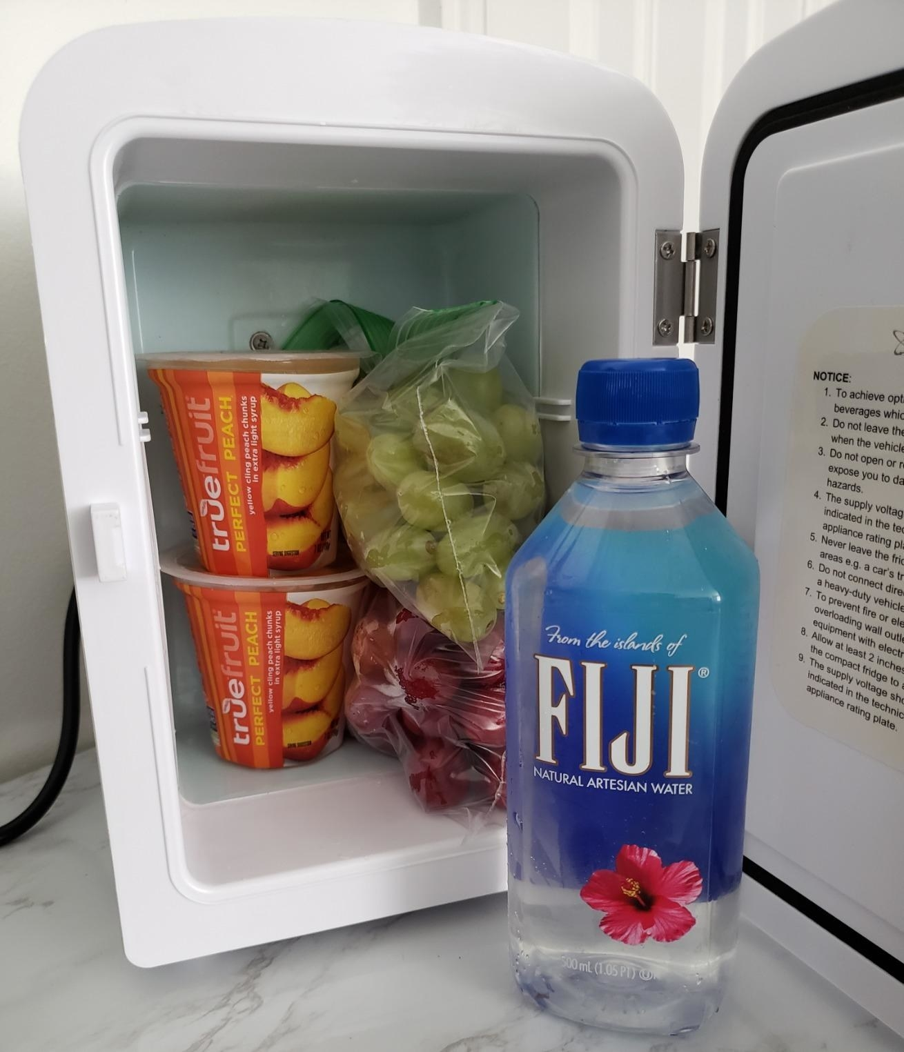 water and some snacks in the fridge