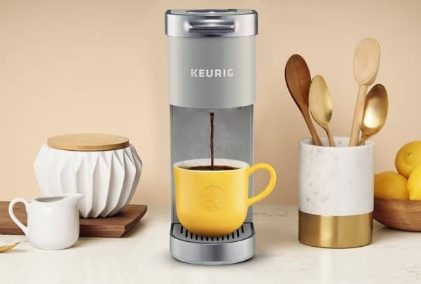 The coffee maker, which is narrow, with space for your cup