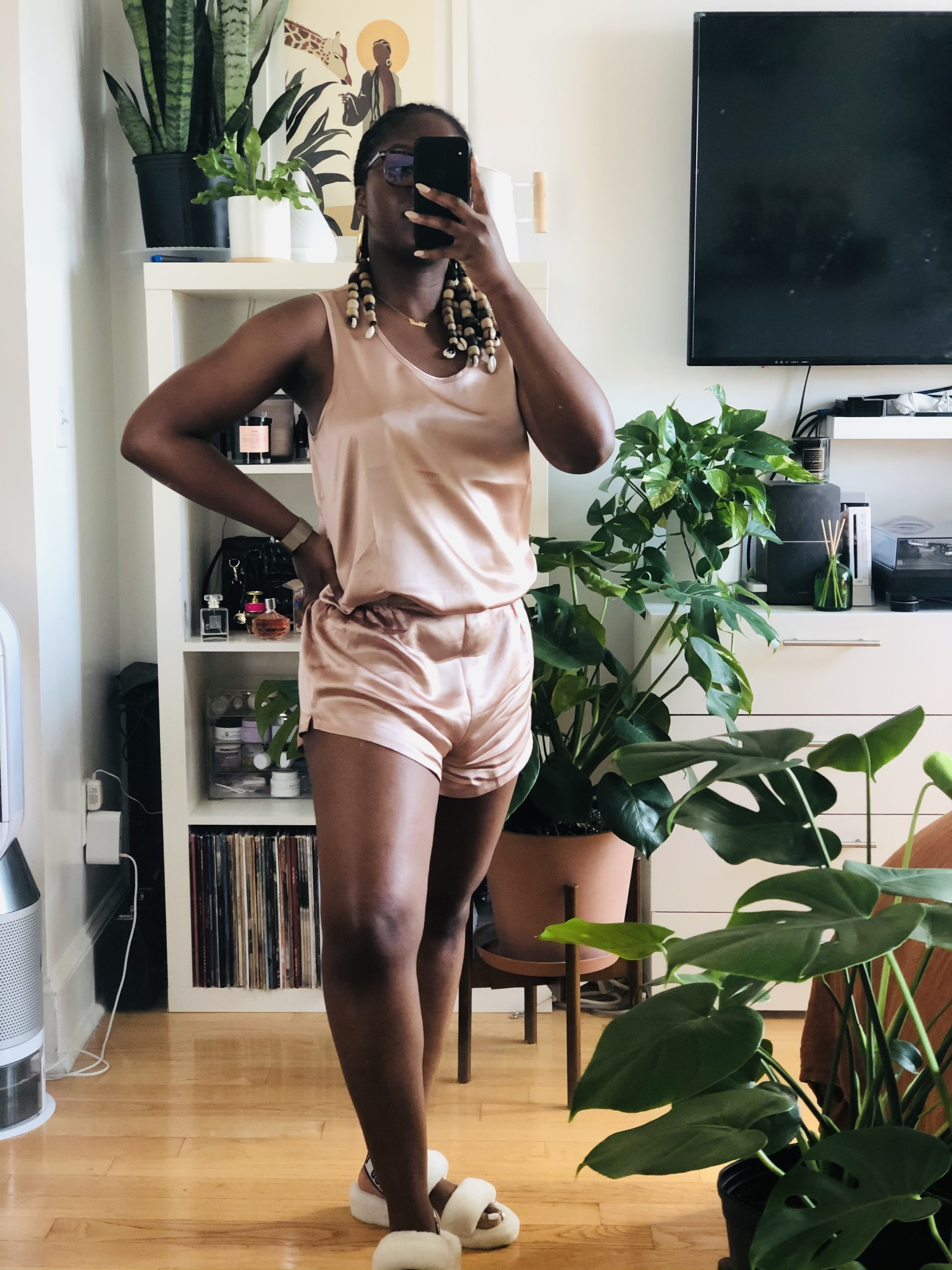A reviewer wearing the pink pajama set