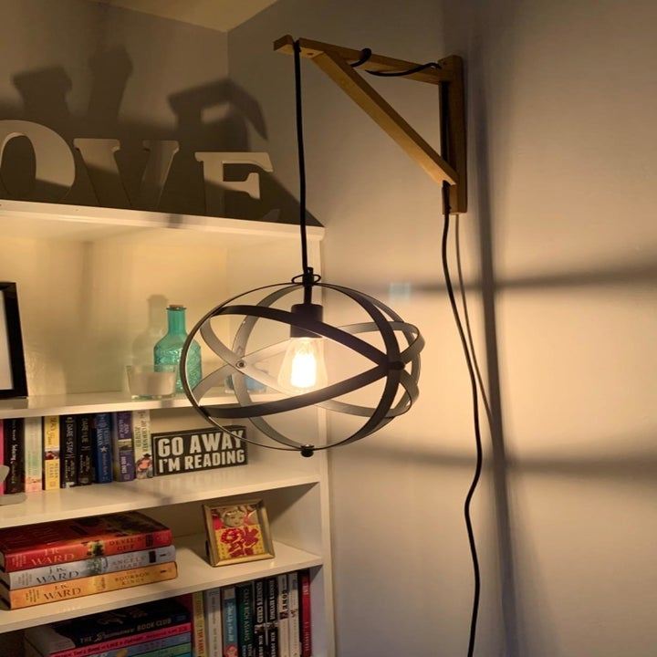 a reviewer photo of the light installed on a wooden wall post