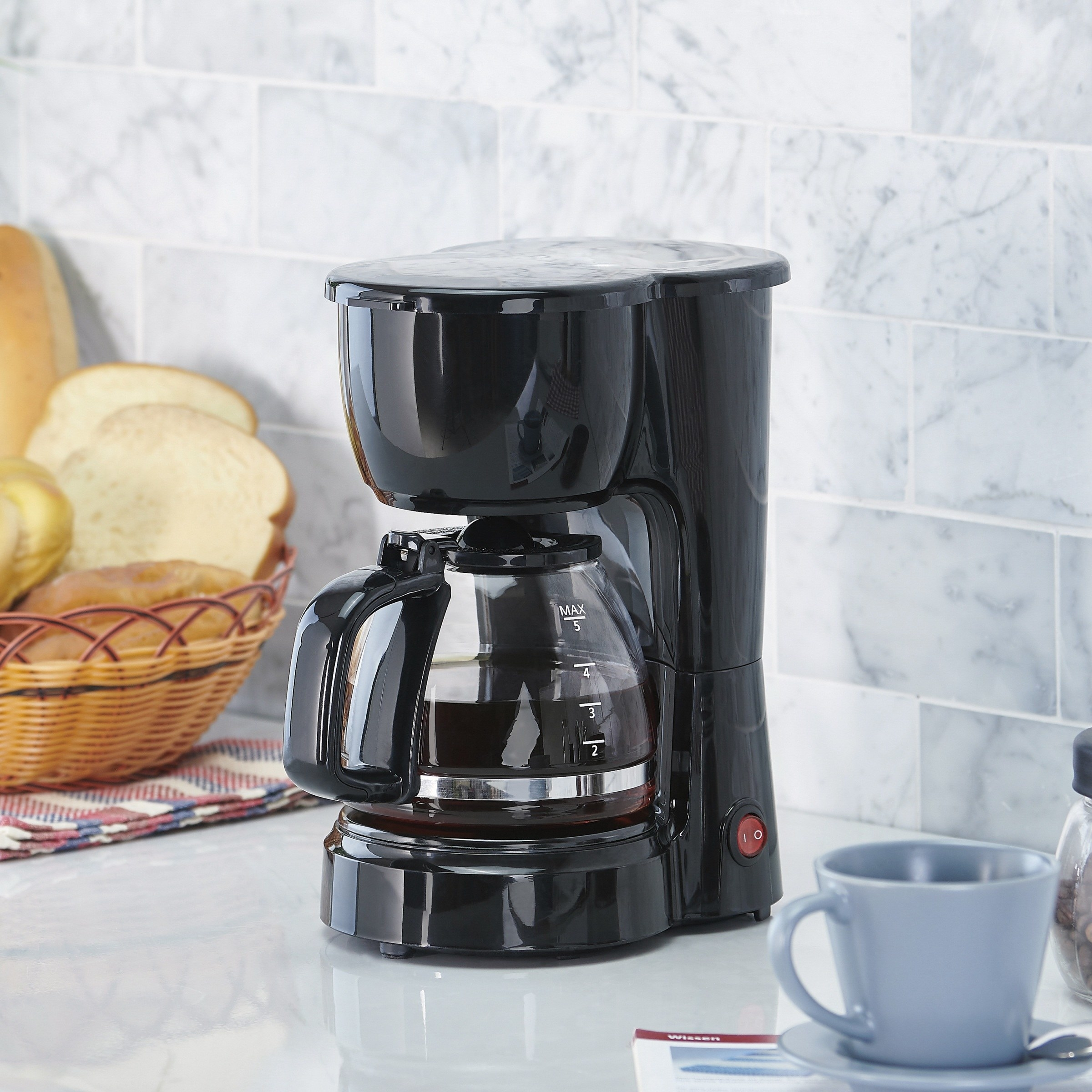black coffee maker on a counter