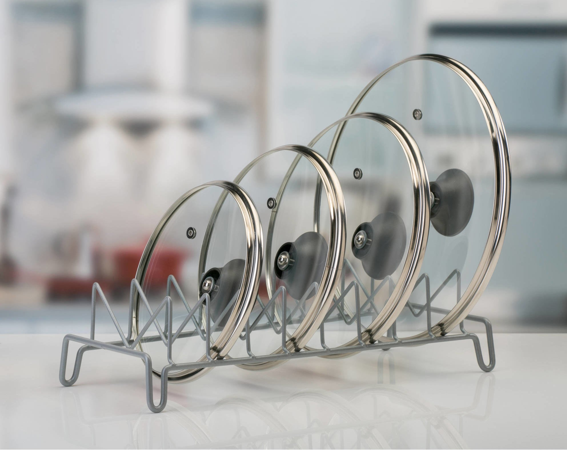 lid organizer with four clear lids stacked side by side