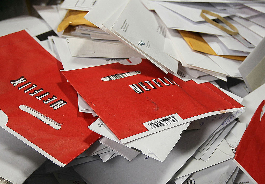 Netflix DVD envelopes in a pile of mail