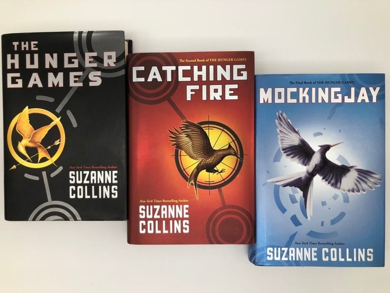The three Hunger Game books on a white table top