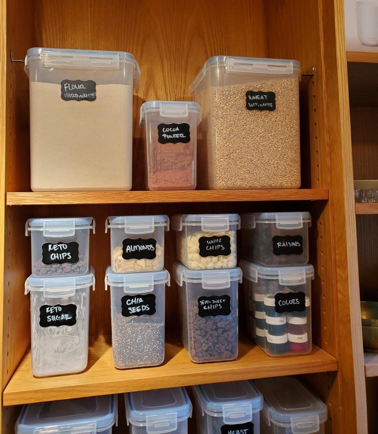 reviewer image of the full 15 piece Vtopmart Airtight Food Storage Containers Set in a cabinet being used to store different kinds of food
