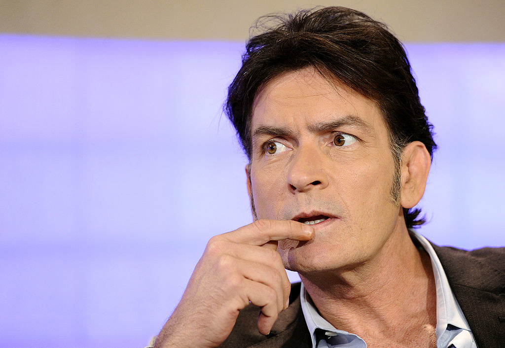 Charlie Sheen looking to the side with his finger under his mouth during an interview with the Today Show