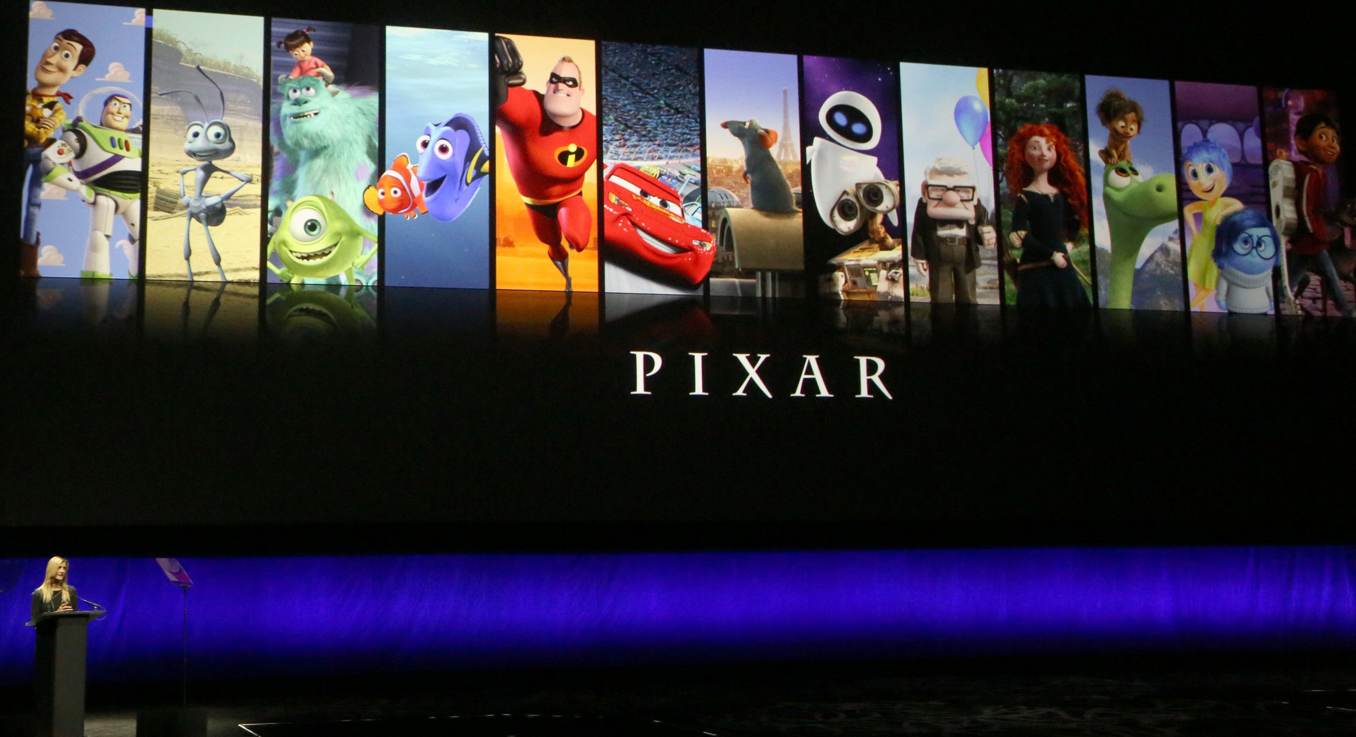 A presentation showing the title 'Pixar' with vertical banners of different Pixar movies, including Toy Story, Monsters Inc, and the Incredibles