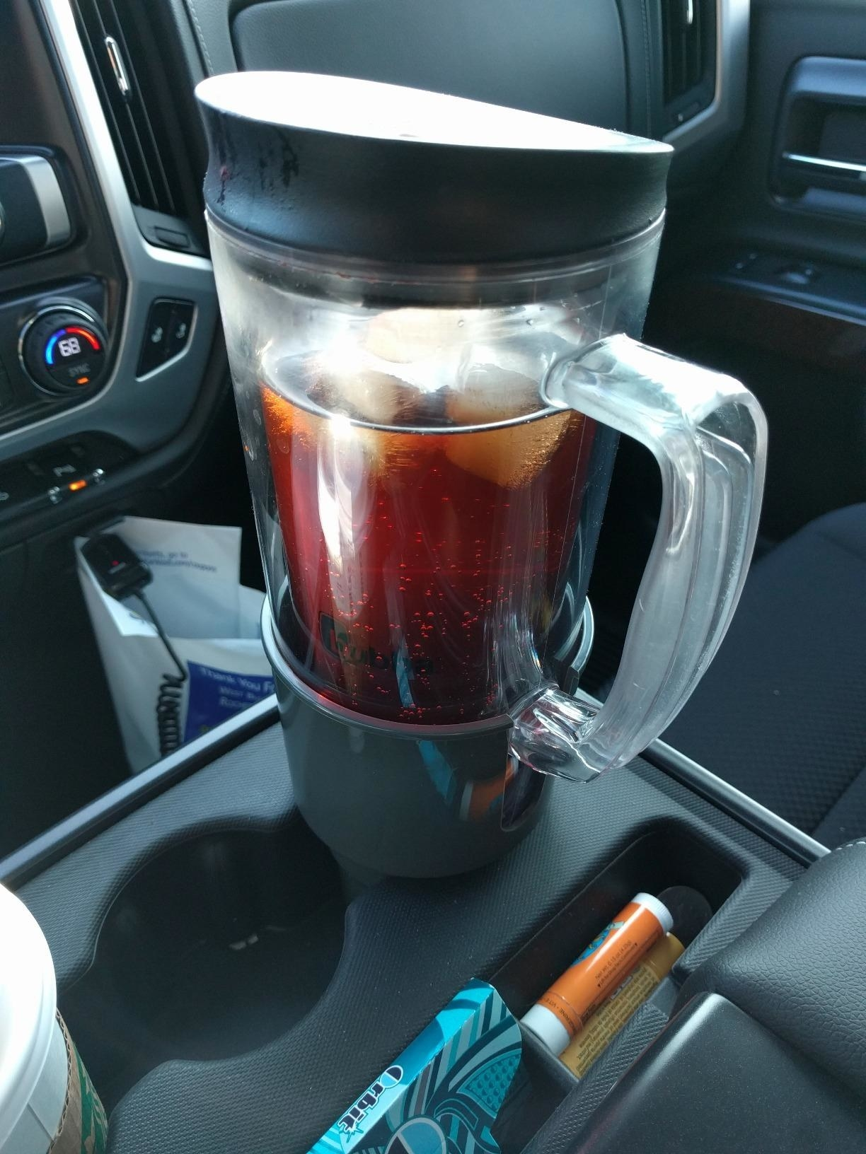 a large cup in the cupholder extender