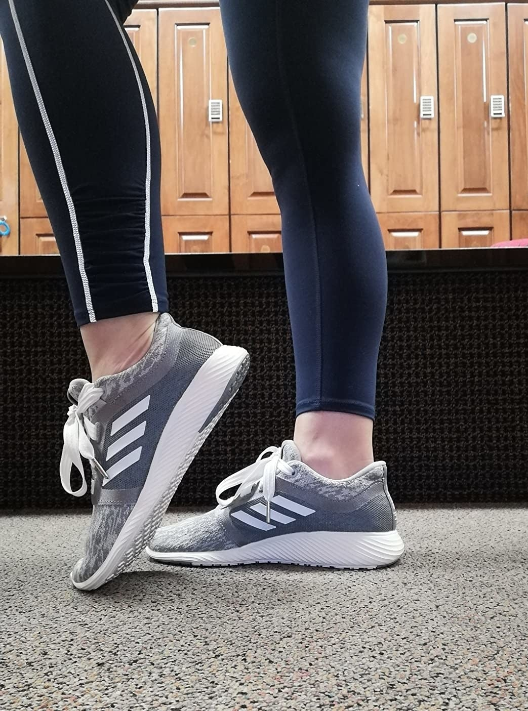 Reviewer wearing Adidas Edge Lux Clima running shoes